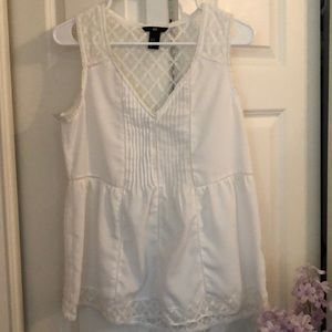 Sleeveless blouse cream color size 10